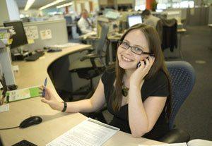 Smiling at Her Desk